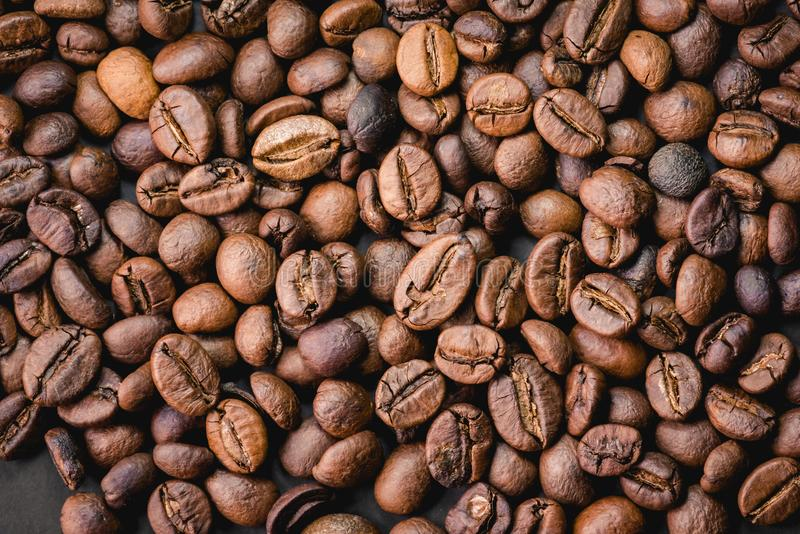 Coffee incup and coffee beans are the background. stock photo