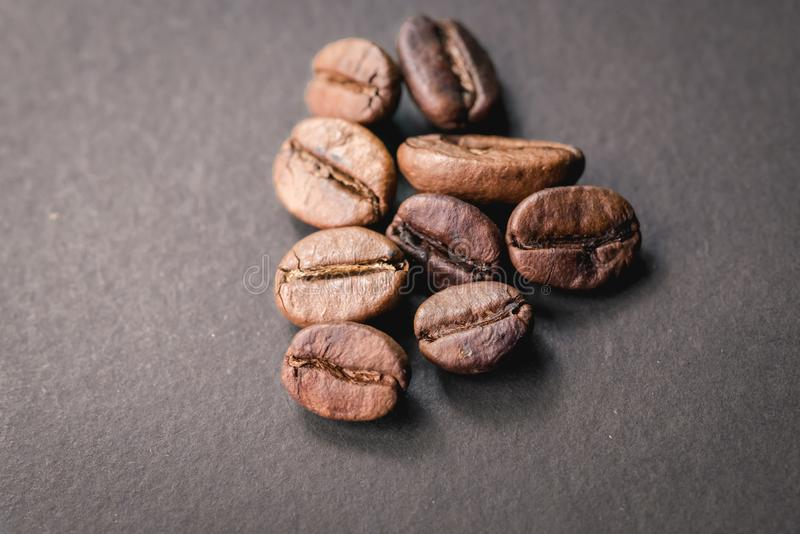 Coffee incup and coffee beans are the background. stock image