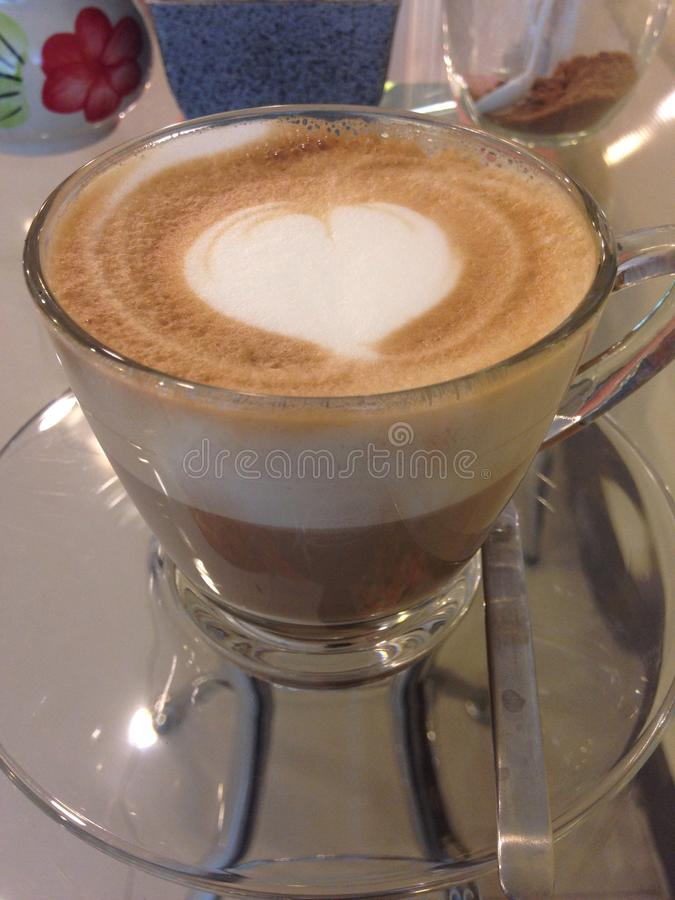 Coffee. Late coffee make hart with milk royalty free stock photography
