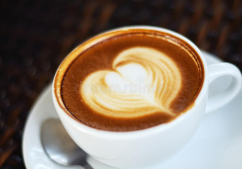 Coffee latte art. Close up Coffee latte art on black background royalty free stock image
