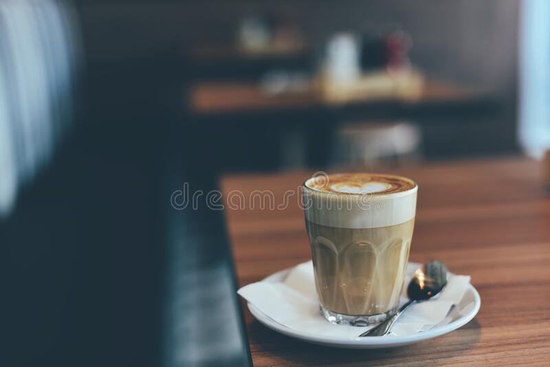 Coffee with latte art stock photography