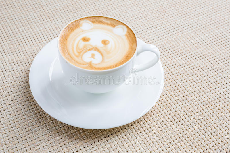Coffee latte art. In white cup stock image