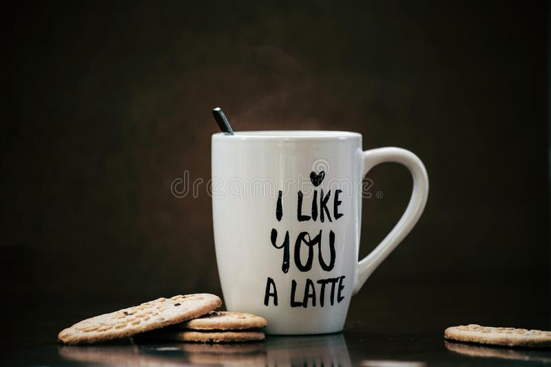 Coffee latte and cookies with white mug and the text i like you a latte. Cappuccino royalty free stock photo