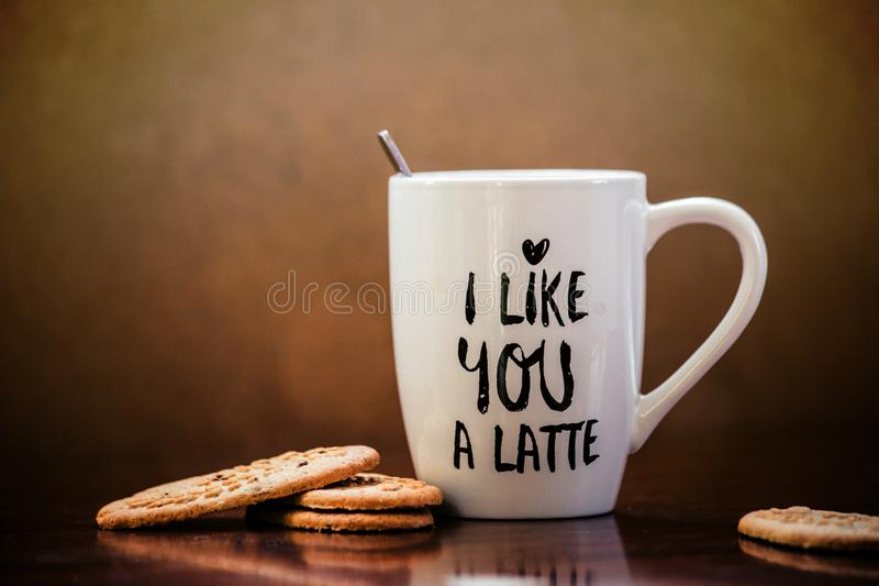 Coffee latte and cookies with white mug and the text i like you a latte. Cappuccino stock photos