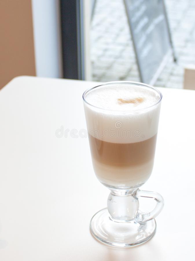 Coffee Latte in glass with great white foam stock image