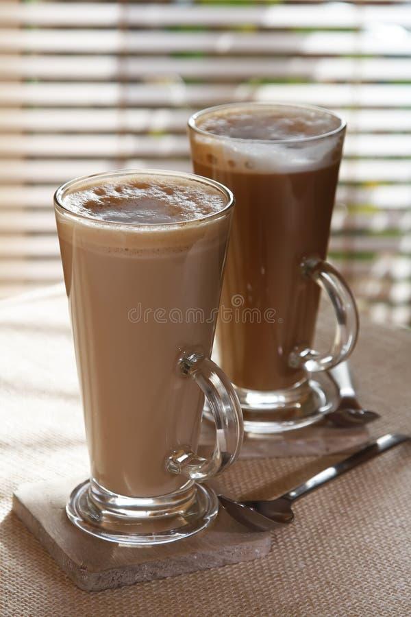Coffee latte macchiato in tall glasses stock photos