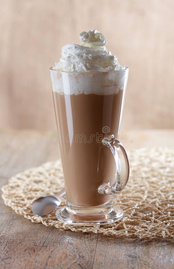 Coffee latte macchiato with whipped cream royalty free stock photography