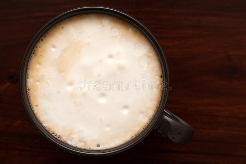 Coffee latte on wooden background. Shot of coffee latte on wooden background stock photography