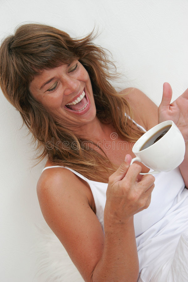 Coffee and laughter. Woman laughing while drinking coffee