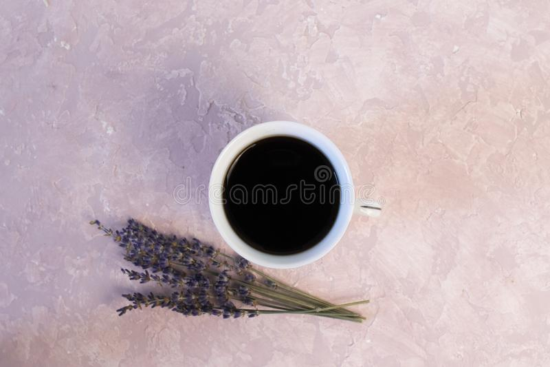 Coffee and lavender flower on pink table from above. Woman working desk. Cozy breakfast. Mockup. Flat lay style stock images