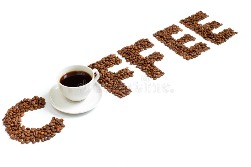 Coffee letters made of beans and cup isolated royalty free stock images