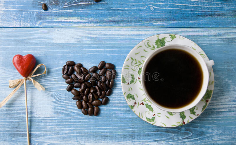 Coffee with love. Still life on a blue wooden background stock photo