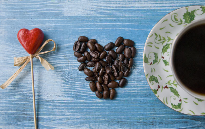 Coffee with love. Still life on a blue wooden background stock images