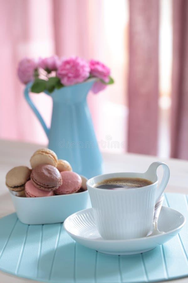 Coffee and macarons stock photography