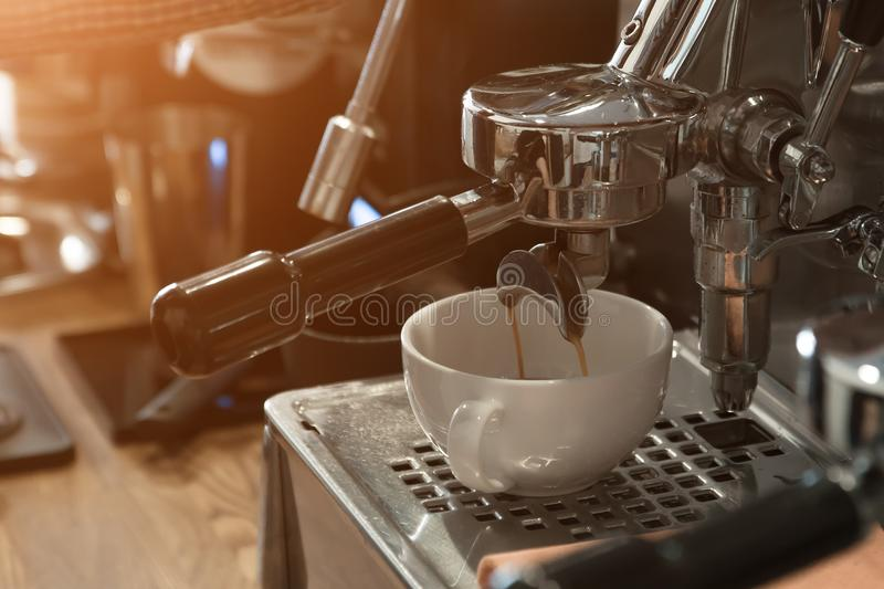 Coffee machine in the cafe makes a cappuccino royalty free stock photos