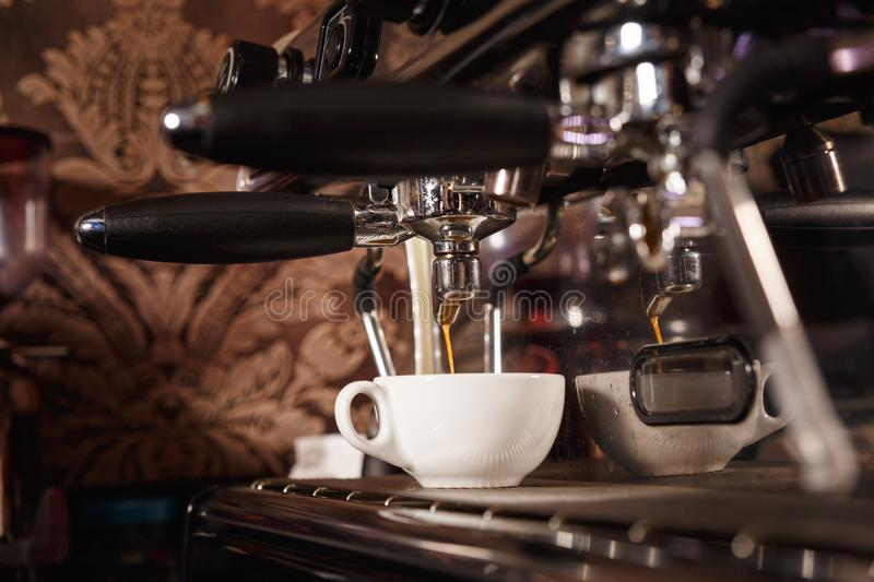 Coffee machine in a cafe pours fresh espresso royalty free stock photos