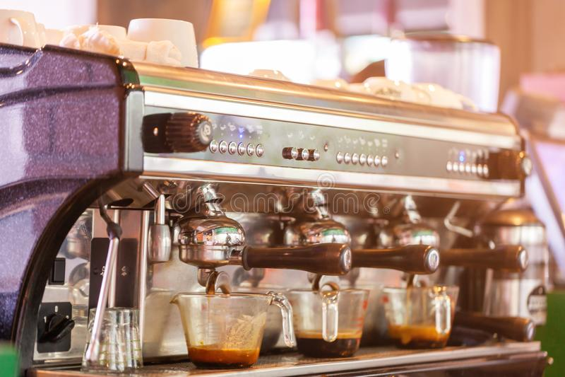 Coffee machine preparing fresh coffee in coffee shop stock photography