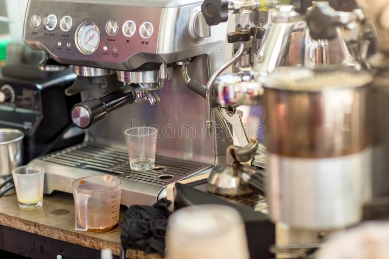 Coffee machine ready to make good a cup of espresso in cafe. coffee machine making a cup of coffee in restaurant. royalty free stock photos