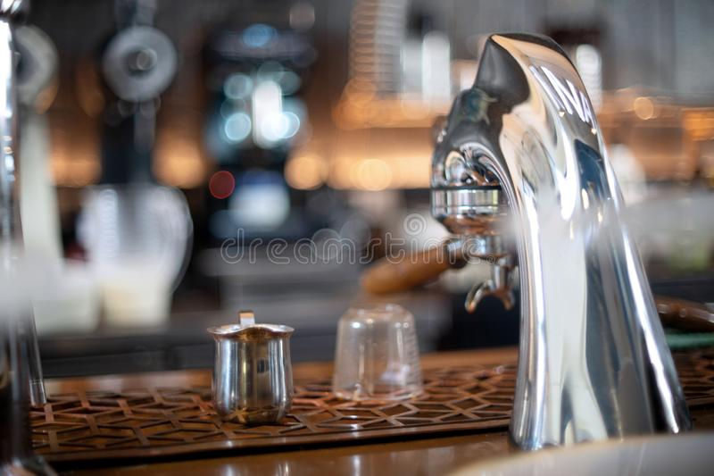 Coffee maker head in the coffee royalty free stock photos