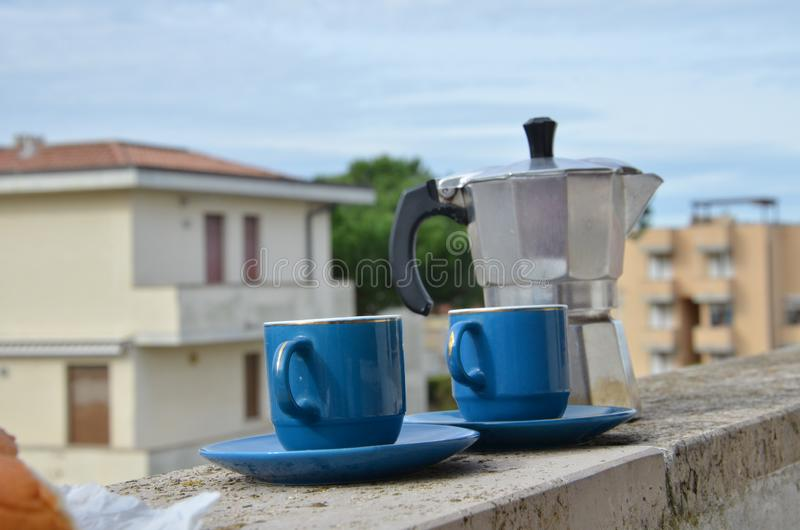 Coffee maker moka pot with roasted coffee beans. Space for text, horizontal. Breakfast concept. Pot and two blue cups of. Coffee maker moka pot and with roasted stock photo