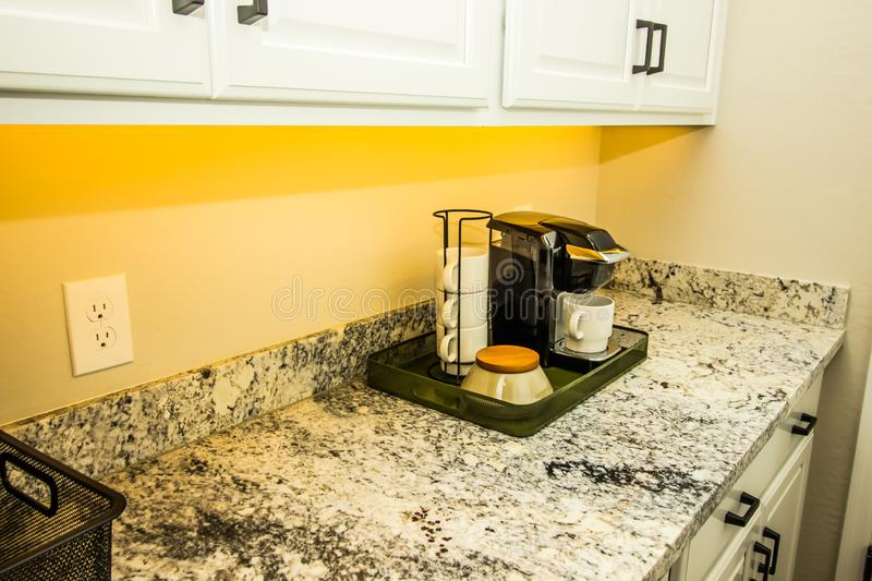 Coffee Maker And Mugs On Portable Tray On Kitchen Granite Counter stock images