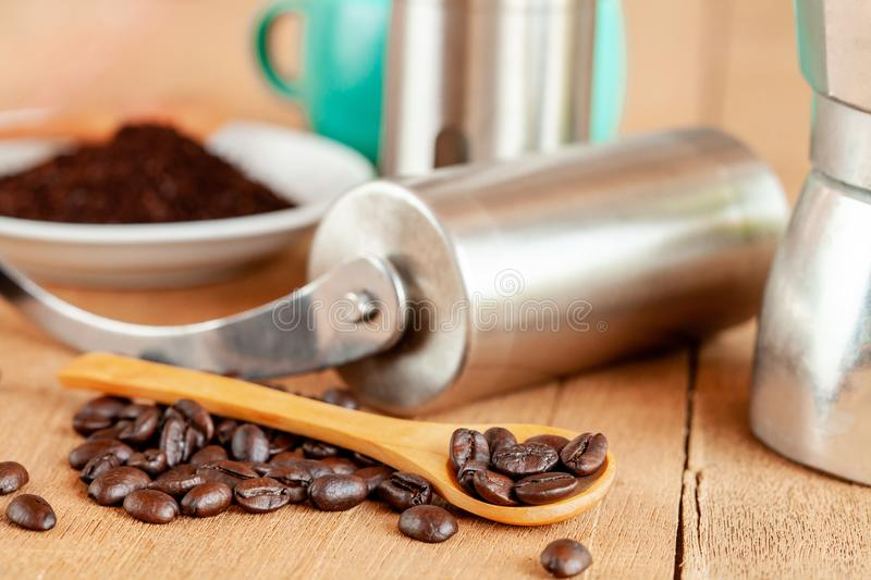 Coffee maker tool and moka pot on wood. Table royalty free stock images
