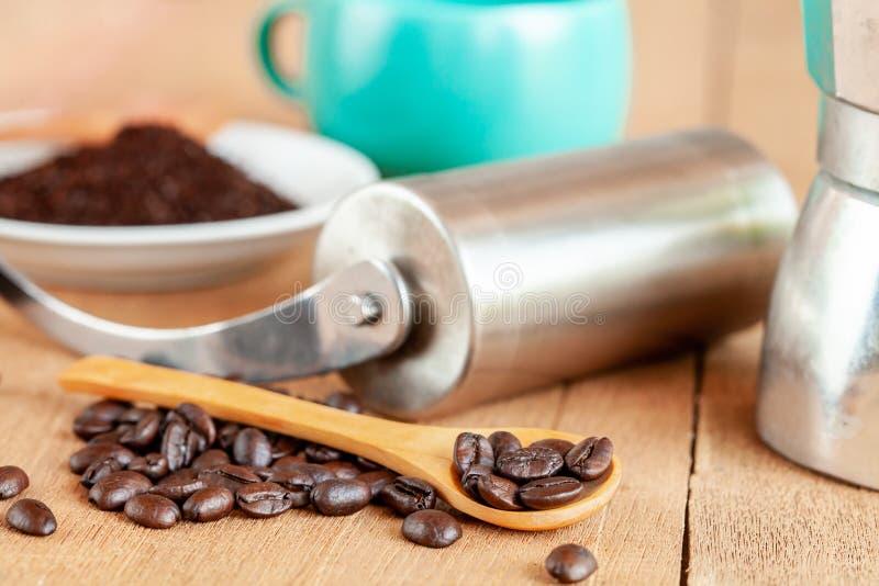 Coffee maker tool and moka pot on table. Coffee maker tool and moka pot on wood table stock images