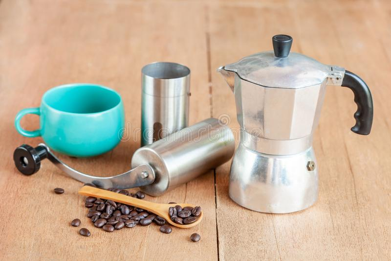 Coffee maker tool and moka pot on table. Coffee maker tool and moka pot on wood table royalty free stock images