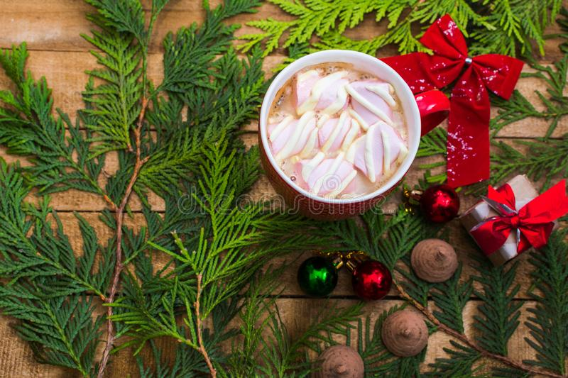 Coffee with marshmallows in the red cup. Christmas and new year mood royalty free stock photography