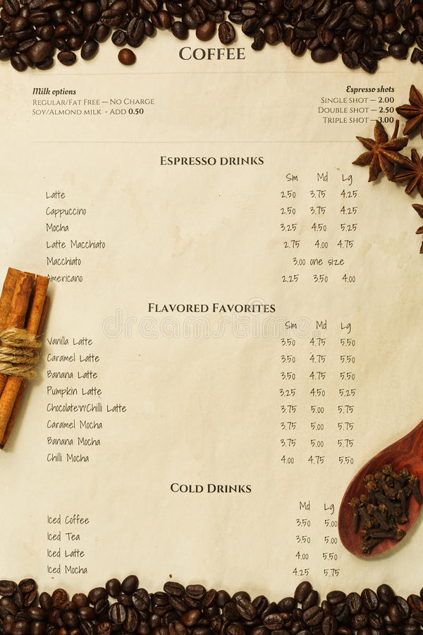 Coffee menu with roasted coffee beans and spices royalty free stock photo