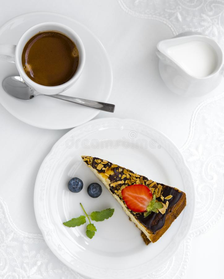 Coffee, milk and cake with strawberry on white plates on a white table. View from above. Flat lay.  stock photos