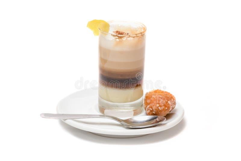 Coffee with milk, cinnamon and lemon royalty free stock photography