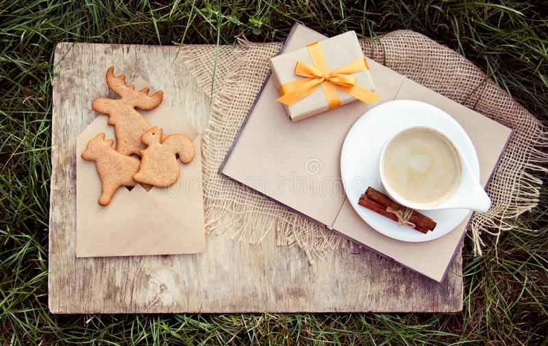 Coffee with milk and cookies in the form of animals. Ginger biscuits and a hot drink. Autumn gift. royalty free stock photography