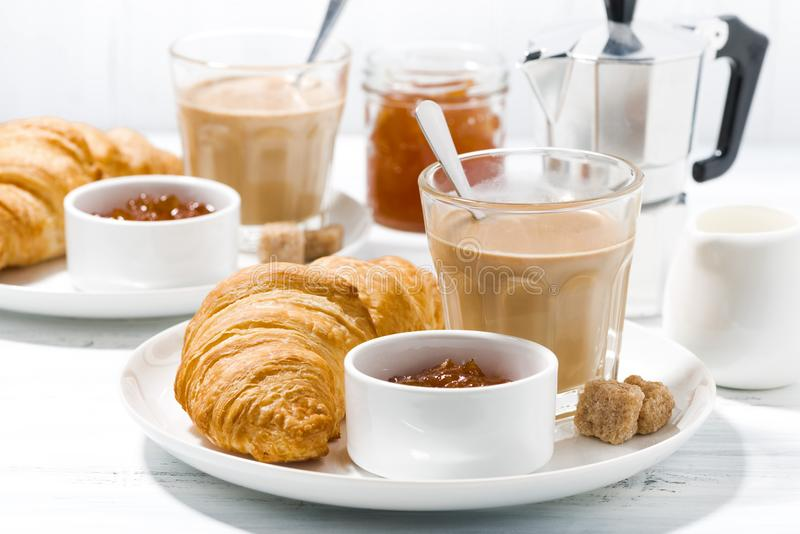 coffee with milk and croissants with jam for breakfast, closeup royalty free stock image