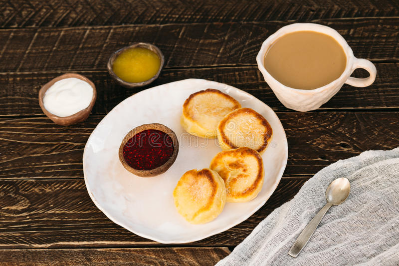 Coffee with milk and curd pancakes stock image