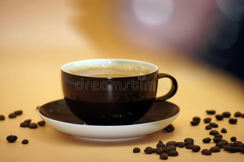 Coffee with milk freed on neutral background. Close UP stock photos