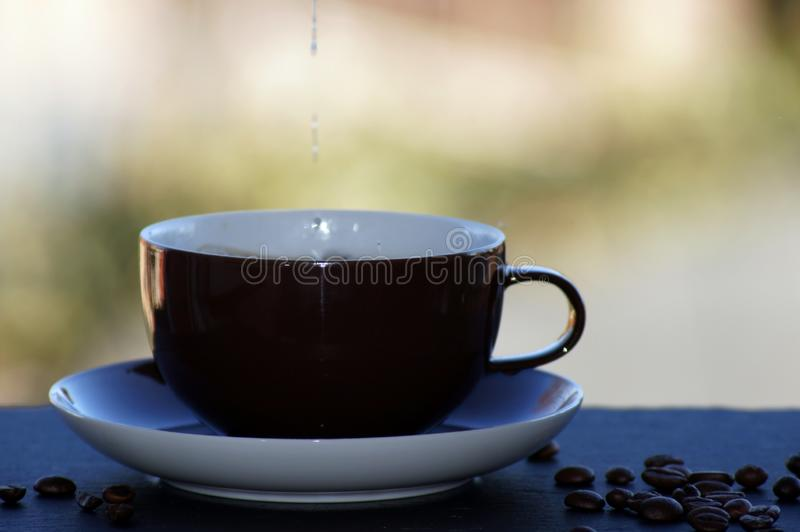 Coffee with milk freed on neutral background. Close UP stock photography