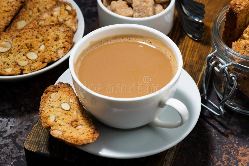 Coffee with milk and Italian cookies cantucci, top view royalty free stock photo