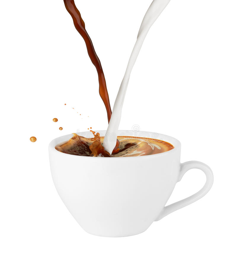 Coffee and milk poured in a cup stock photography