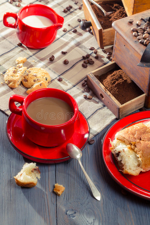 Coffee with milk served with a croissant royalty free stock photo