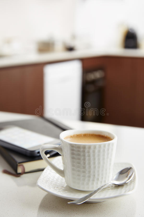 Coffee with milk at work. Coffee with milk with smartphone and notebook royalty free stock images
