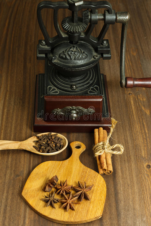 Coffee mill and some spices stock photos