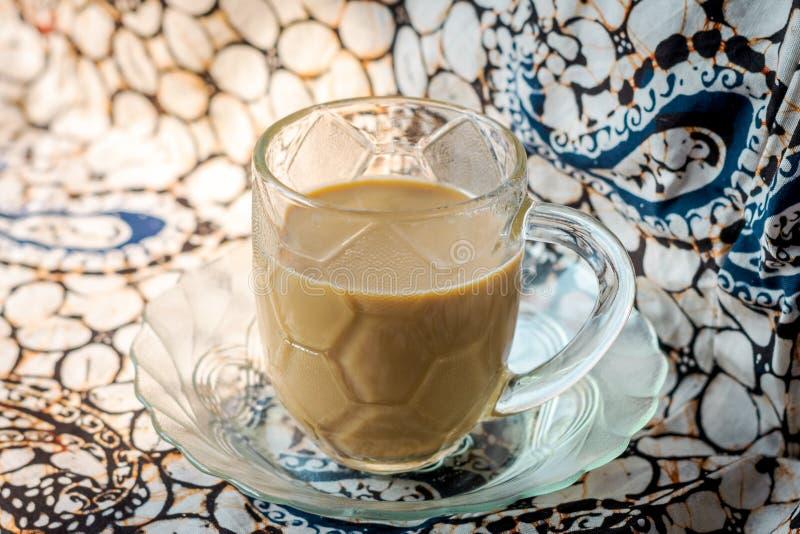 coffee mix milk isolated batik background royalty free stock images