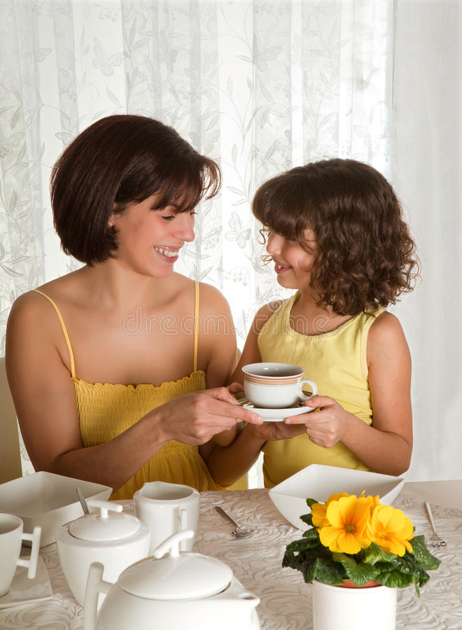 Coffee for mommy. Little girl serving coffee on mother's day stock images
