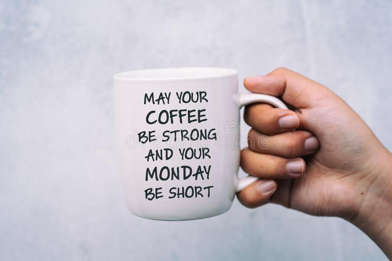 Coffee and Monday Greeting - May your coffee be strong and your Monday be short. Inspirational quotes, coffee and Monday Greeting - May your coffee be strong and stock photos