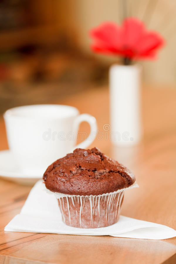 Coffee morning. Breakfast muffin with coffee cup in a cozy home interior royalty free stock photography