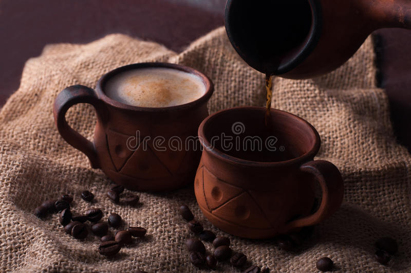 Coffee, morning, coffee beans concept - coffe in earthenware cup stock photography