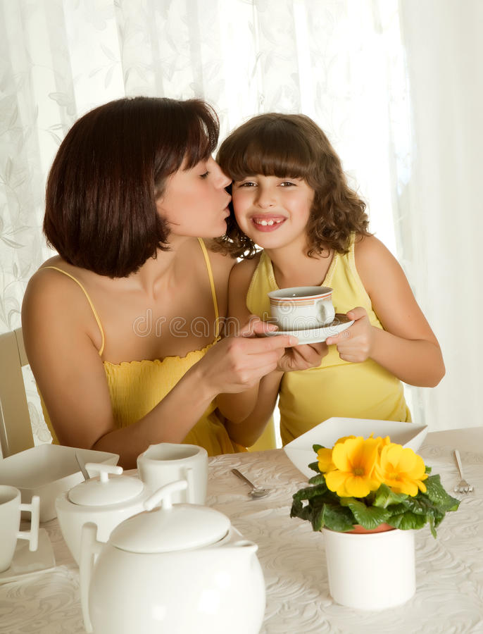 Coffee for mother's day. Little girl serving coffee for mother's day breakfast royalty free stock images