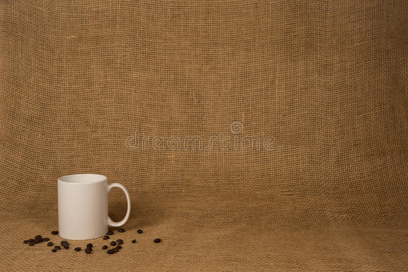 Coffee Mug Background - White Mug and Beans royalty free stock photography