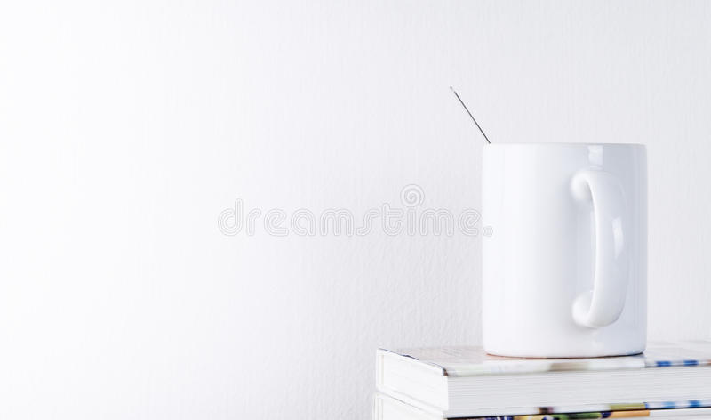 Coffee Mug on book with white background royalty free stock photo